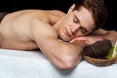 Man relaxing at spa salon — Stock Photo