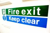 Fire exit keep clear sign — Stock Photo