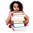 Schoolgirl resting her arms on books — Stock Photo #79024510