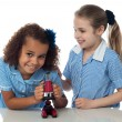 Two little girls with microscope — Stock Photo #81621566
