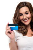 Woman looking at her credit card — Stock Photo