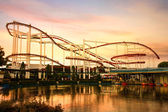 Roller Coaster loops in the sunset. — Stock Photo