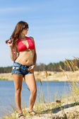 Girl in denim shorts — Stock Photo