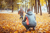 Two brothers in autumn park — Stock Photo