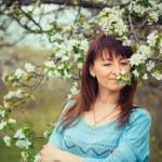 Girl in the flowered garden — Stock Photo #56457959
