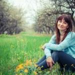 Girl in the flowered garden — Stock Photo #56457963