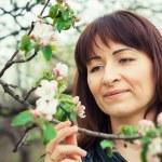Girl in the flowered garden — Stock Photo #56457965