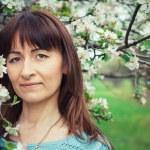Girl in the flowered garden — Stock Photo #56457967