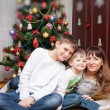 Happy mother and two her sons. Christmas photo — Stok fotoğraf #56853005