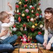 Happy mother and two her sons. Christmas photo — Stock fotografie #56853007