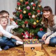 Happy mother and two her sons. Christmas photo — Stok fotoğraf #56853015