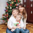 Happy mother and two her sons. Christmas photo — Stok fotoğraf #56853017