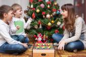 Happy mother and two her sons. Christmas photo — Stock Photo