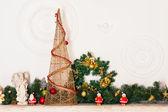 Decorative fireplace and tree — Stock Photo