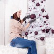 Beautiful girl near christmas tree — Stock Photo #62164053