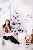 Beautiful girl near christmas tree — Stock Photo