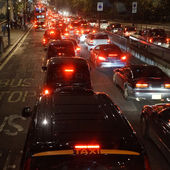 Evening traffic, London city lights — Stock Photo