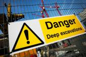 Warning sign at construction site — Stock Photo