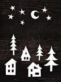 Christmas paper decorations on dark wooden background — Stok fotoğraf