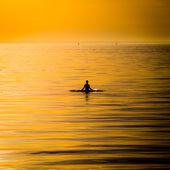Ocean woman in sunset light — Stockfoto