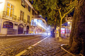 Traditional yellow tram downtown Lisbon — Stock Photo