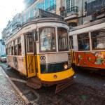 Traditional yellow tram downtown Lisbon — Stock Photo #54406401