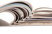 Stack of magazines on white background — Stock Photo