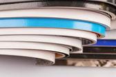 Pila de revistas sobre fondo blanco — Foto de Stock