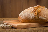 White bread over wooden background — Stock Photo