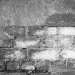 Brick wall with cracked plaster - texture — Stock Photo #63789051