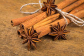 Close up of cinnamon sticks and star anise on wood — Stock Photo