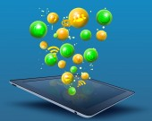Tablet and an icon in flying the balls. — Stock Photo
