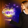 Caucasian appearance girl holding tablet on hand. Icons skyscrapers and graphs. — Stock Photo #60258671