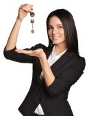 Beautiful girl broker holding sale house key. — Stock Photo