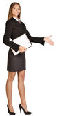 Business woman stretches out a hand of greeting. holds clipboard. — ストック写真