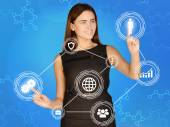 Girl touches the human icons and gears — Stock Photo