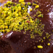 Detail of Chocolate Cake with Pistachio Particles — Stock Photo #64631891