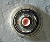 Bell button on the wall — Stockfoto