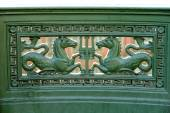 Cast iron with a bas-relief of a horse — Stock Photo