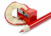 Red pencil and pencil sharpener — Stock Photo