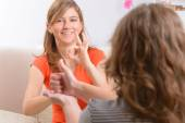 Deaf woman learning sign language — Stock Photo