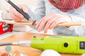 Cutting the batten with rotary saw — Stock Photo