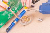 Serviceman soldering on PCB — Stock Photo