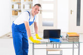 Smiling cleaner at the office — Stock Photo
