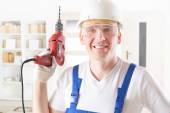 Man with electric drill  — Stock Photo