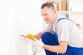Electrician checking socket — Stock Photo