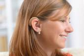 Woman wearing deaf aid — Stock Photo