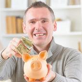 Man saving money — Stock Photo