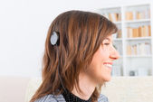 Woman showing cochlear implant — Stock Photo