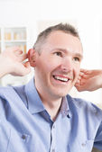 Man wearing deaf aid — Stock Photo